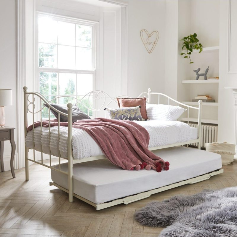 Cream-painted day bed with trundle