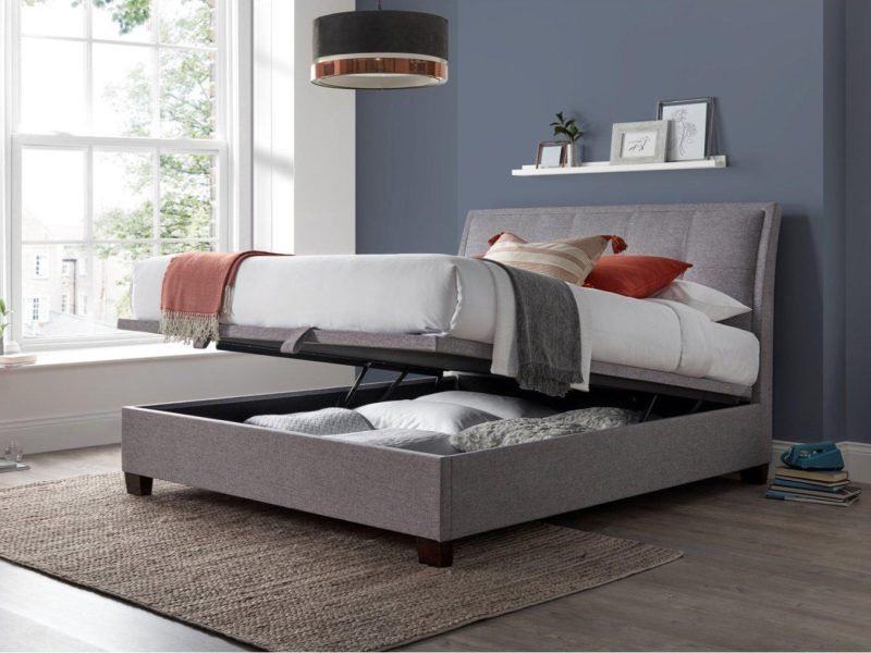 Grey fabric bed frame with lift-up storage base