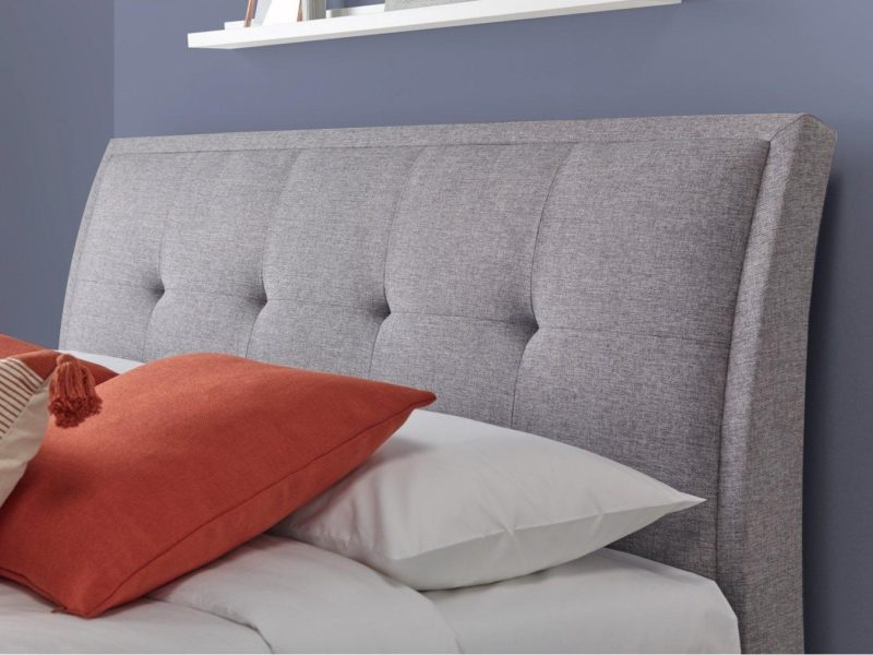 Grey fabric cushioned headboard