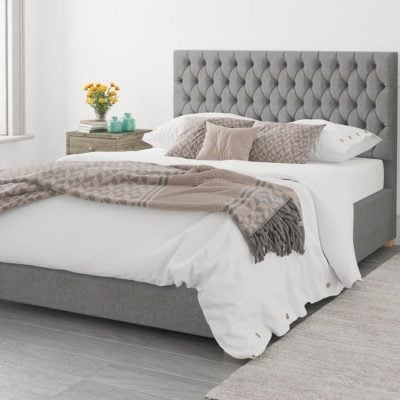 Grey fabric bed frame with padded headboard