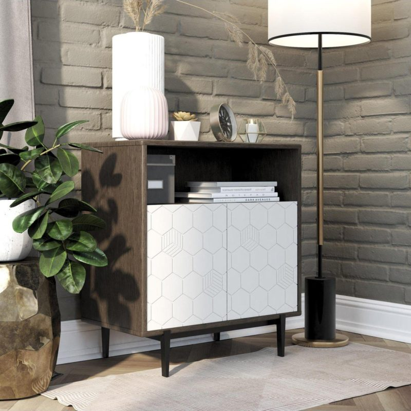 Storage cabinet with open shelf space and geometric patter doors
