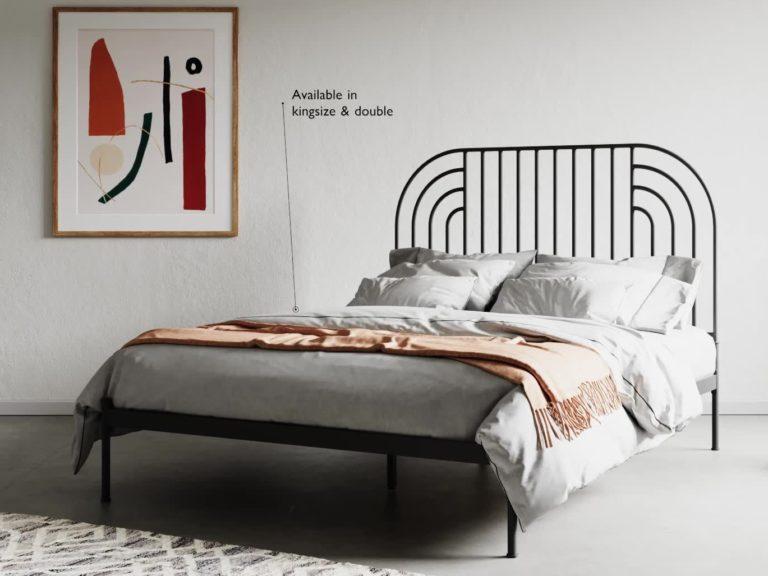 Black metal bed frame with swirl design headboard