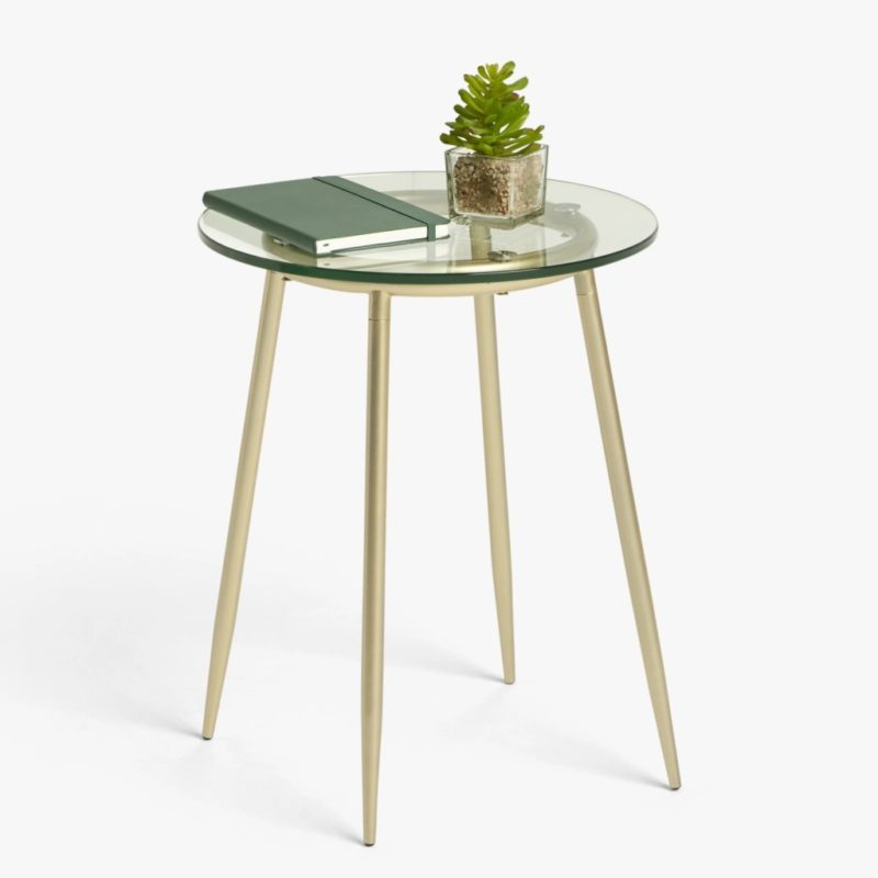 Round, glass topped side table with gold coloured tapered legs and frame
