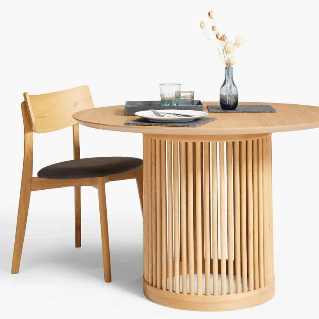 Round oak dining table with spindle rod base