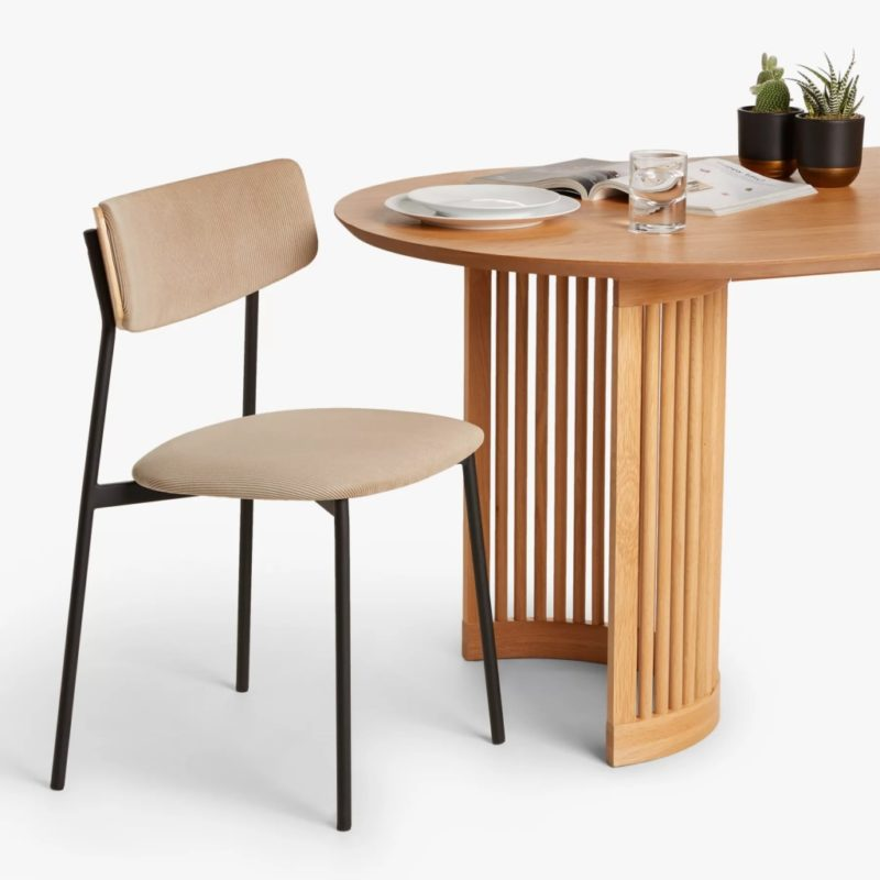 Curved oak dining table with spindle frame base