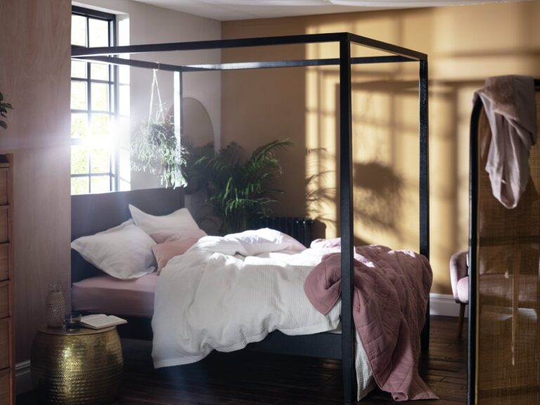Black-painted four poster bed frame