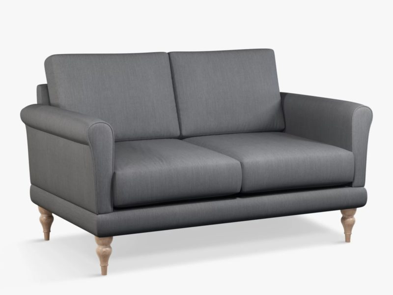 Small grey fabric sofa with scrolled arms