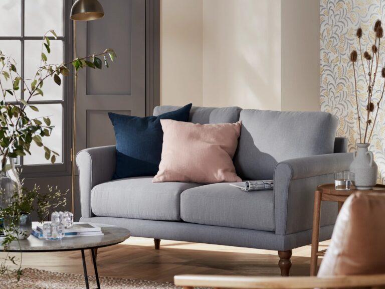 Grey fabric scroll armed sofa