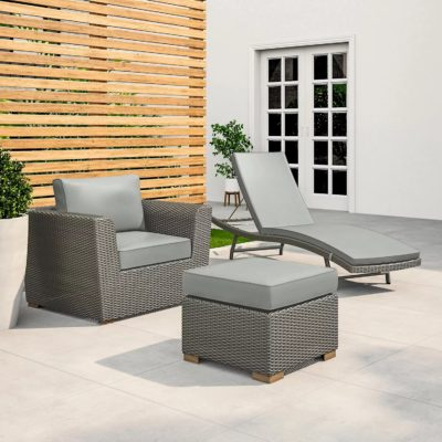 Grey rattan armchair, lounger and footstool with grey cushions