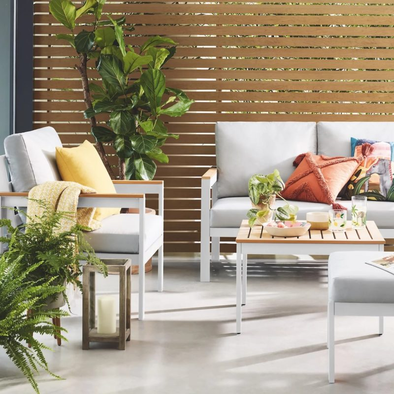 White-painted garden furniture with grey cushions