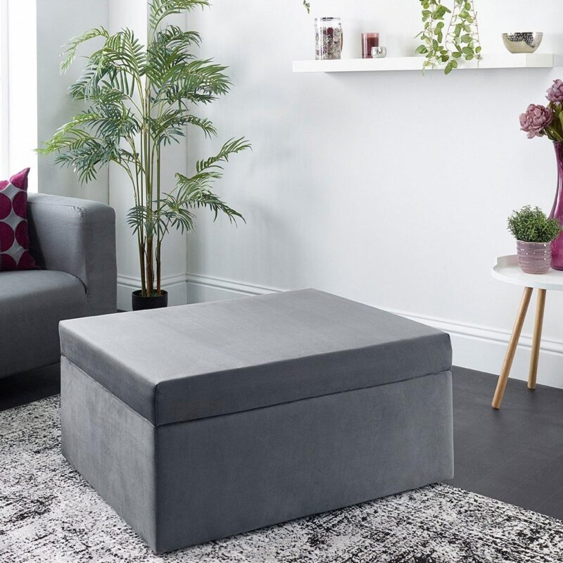 Guest bed contained in a footstool
