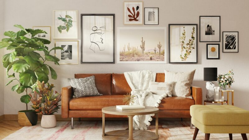 A well designed living room featuring a leather sofa and lots of pictures