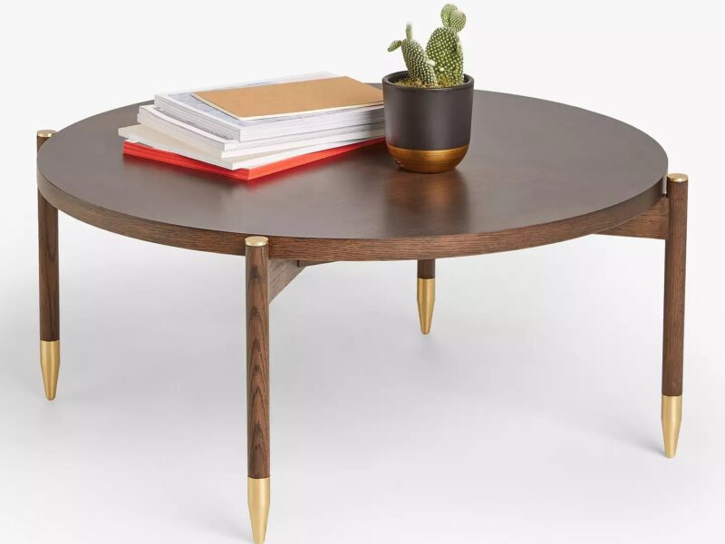 Round coffee table with dark oak finish and brass tipped legs