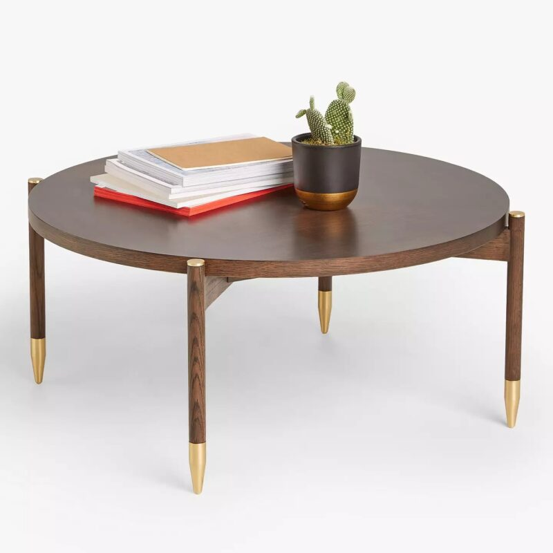 Round coffee table with brass-tipped legs