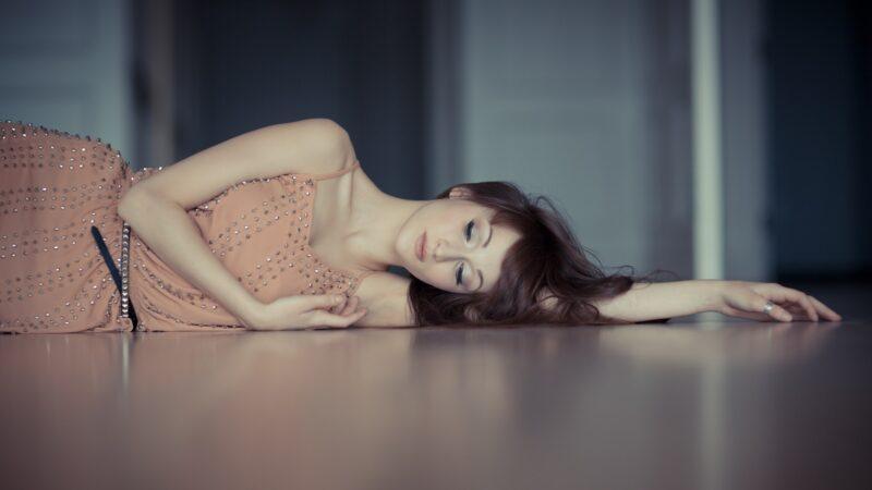 Lady lying on a warm floor