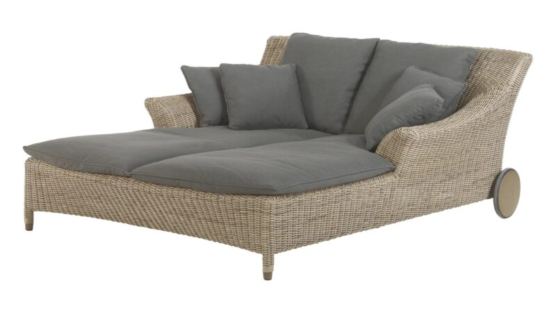 Double wicker sun bed with grey cushions