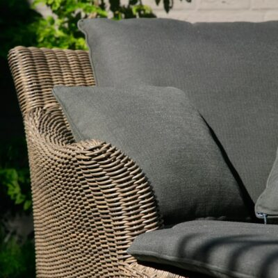Wicker sun bed with grey cushions