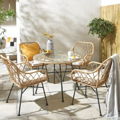 4-seater cane dining table with glass top and 4 matching chairs