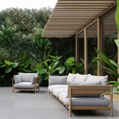 Teak outdoor sofas with grey cushions