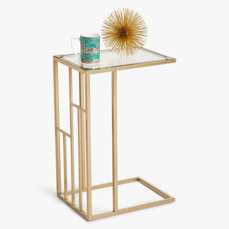 Gold coloured side table with glass top