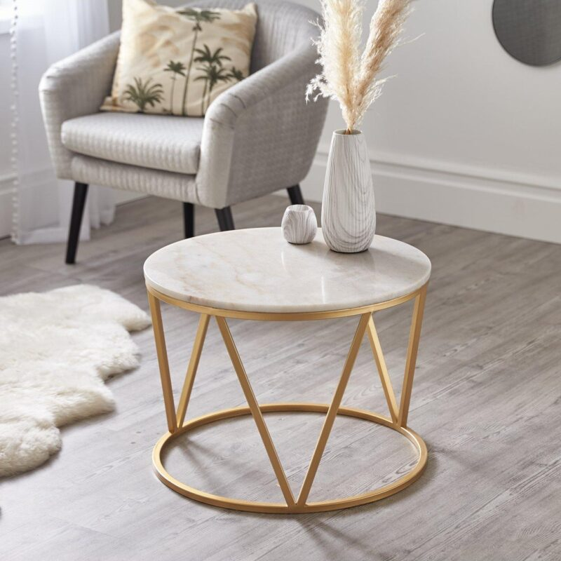 Round marble coffee table with brass coloured base