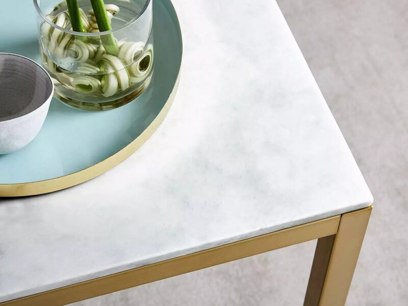 Marble top table with brass-coloured legs