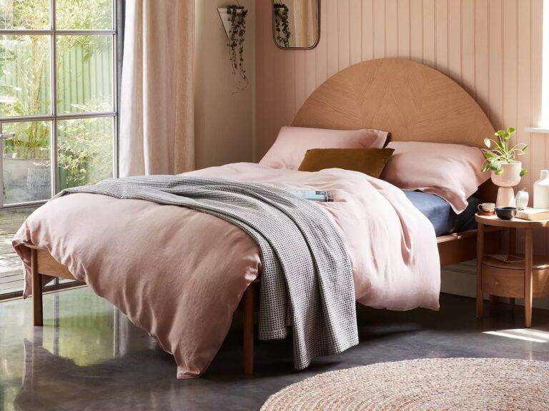 Oak bed with large semi-circular headboard