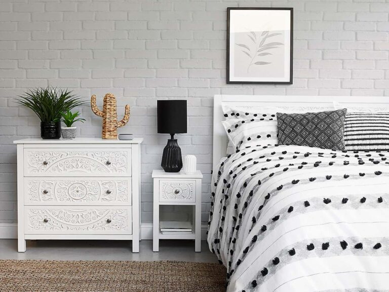 Whit-painted bedroom furniture with elegant carved detailing