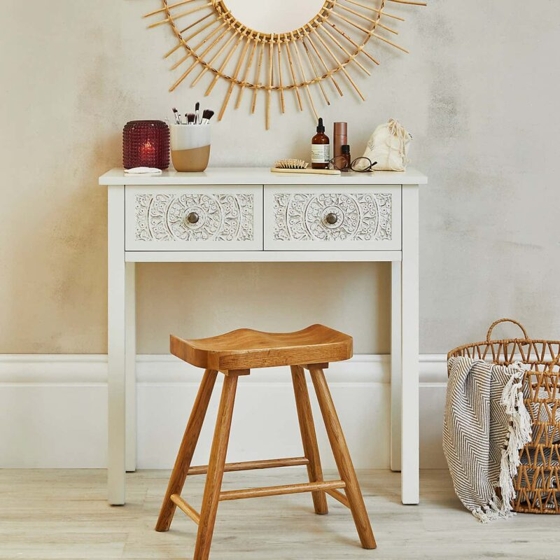 White dressing table with carved drawer fronts