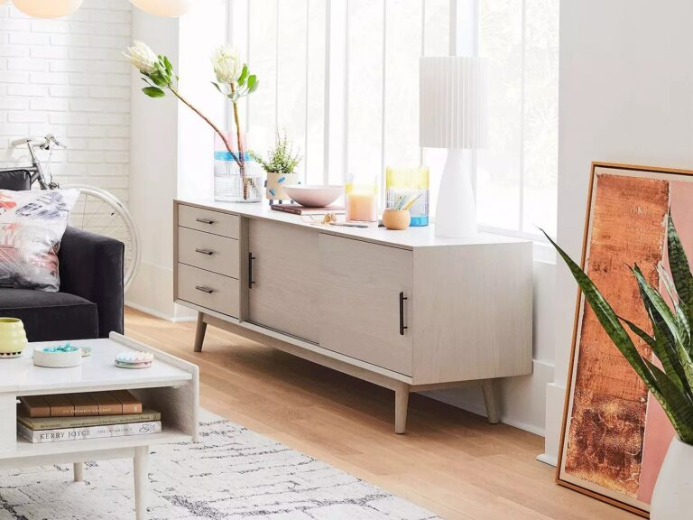 Mid-century style sideboard with grey finish and gold coloured legs