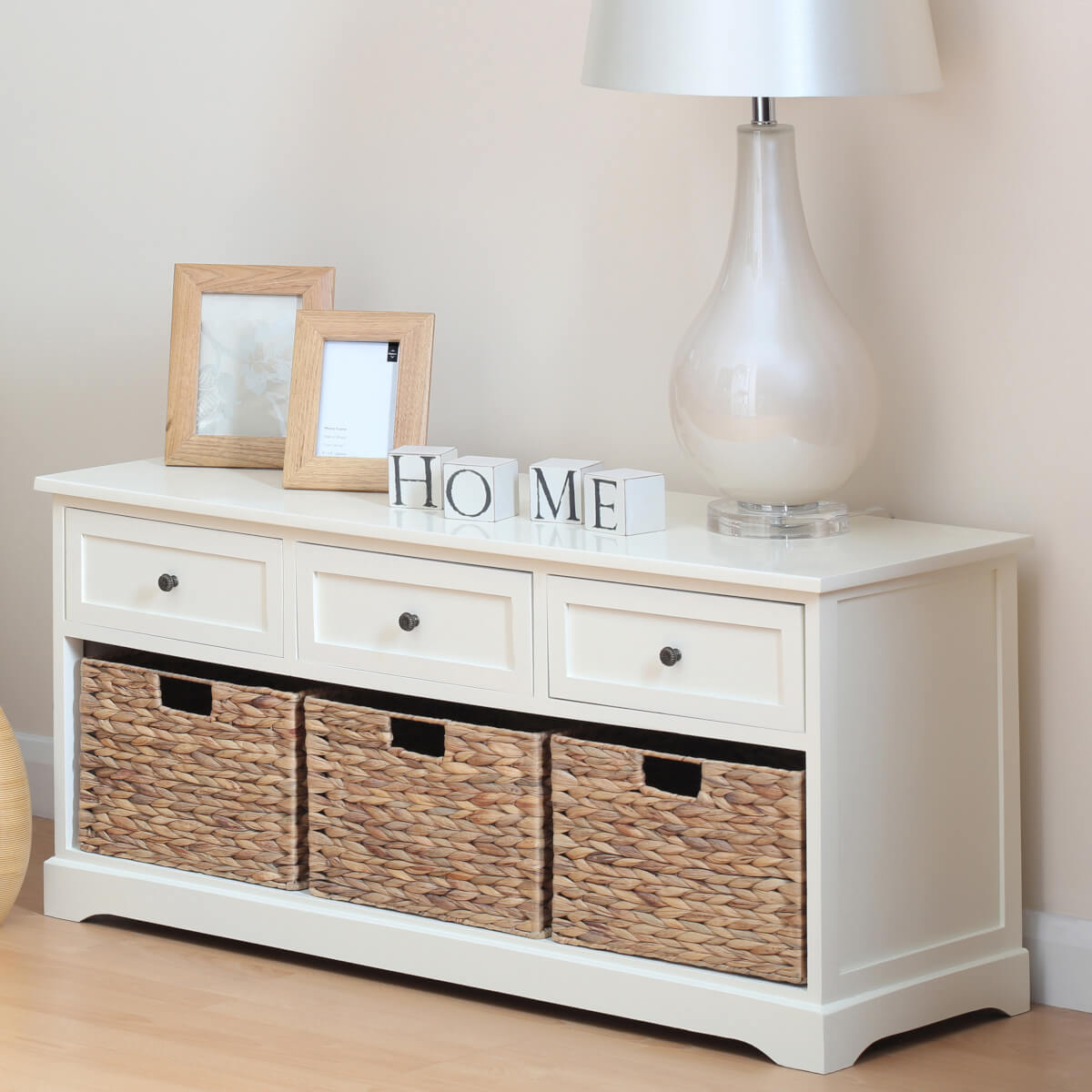 White painted hallway bench with 3 drawers and 3 baskets