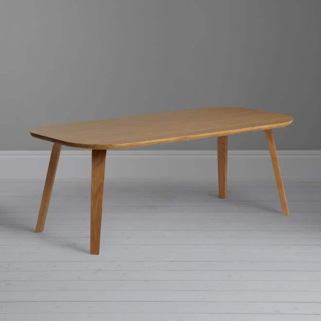 Birch and oak coffee table with curved legs and rounded top