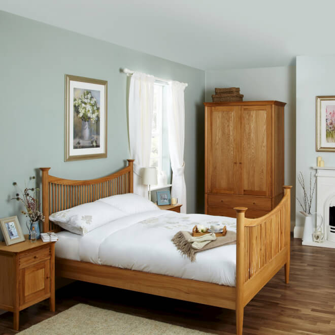 Solid oak bedstead, bedside table and wardrobe unit
