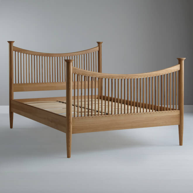 Oak bed frame with spindled head and foot boards