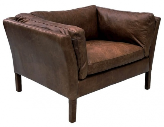 Low back armchair upholstered in real leather