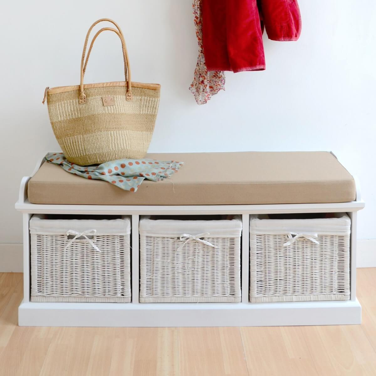 White painted storage bench with 3 woven baskets